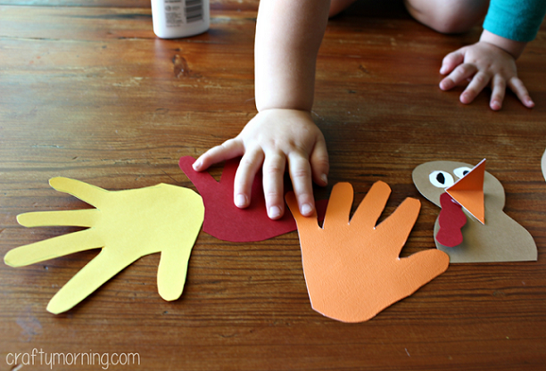 Handprint turkey hat for a thanksgiving craft crafty morning for Craft hats for kids