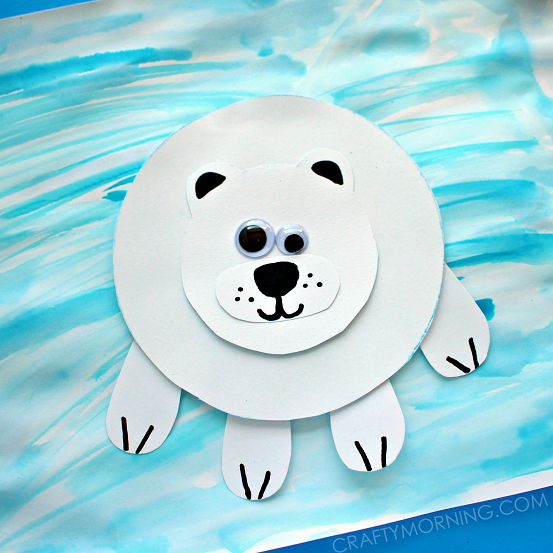 take a black marker and add all the polar bear s details glue the