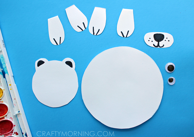 Cut out the polar bears body, legs, nose, and face. To make it easy ...