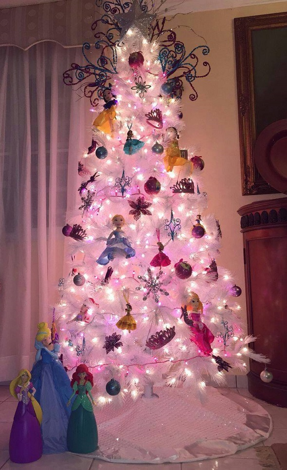 make a disney princess themed christmas tree by adding tons of princess ornaments and pink lights on a white tree found on pinterest
