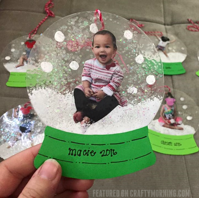 Laminated photo snowglobe ornaments crafty morning for Snow globe craft for kids
